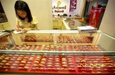 Giá vàng châu Á chịu sức ép đi xuống khi đồng USD mạnh lên
